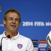 Photo - United States' head coach Jurgen Klinsmann attends a press conference before a training session in Recife, Brazil, Wednesday, June 25, 2014. The U.S. will play Germany in group G of the 2014 soccer World Cup on June 26. (AP Photo/Julio Cortez)