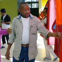 Photo -   John Ford of Alexandria, La., gets ready to cast his vote at Precinct C07 at Peabody Magnet High School Tuesday, Nov. 6, 2012 in Alexandria. (AP Photo/The Daily Town Talk, Melinda Martinez) NO SALES