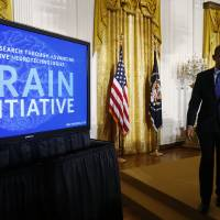 Photo - President Barack Obama leaves the stage in the East Room of the White House in Washington, Tuesday, April 2, 2013, after he spoke about the BRAIN (Brain Research through Advancing Innovative Neurotechnologies) Initiative. (AP Photo/Charles Dharapak)