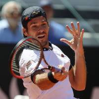 Photo - Germany's Tommy Haas returns the ball to  Switzerland's Stanislas Wawrinka during their match at the Italian open tennis tournament in Rome, Thursday, May 15, 2014. (AP Photo/Gregorio Borgia)