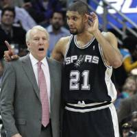 Photo - San Antonio Spurs coach Greg Popovich talks with center Tim Duncan during a break in the action against the New Orleans Hornets in the second half of an NBA basketball game in New Orleans, Monday, Jan. 18, 2010. The Spurs defeated the Hornets 97-90. (AP Photo/Bill Haber) ORG XMIT: LAWH108