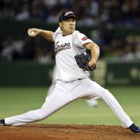 Photo - FILE - In this March 12, 2013, file photo, Japan's Masahiro Tanaka pitches against the Netherlands in the fifth inning of a World Baseball Classic second round game at Tokyo Dome in Tokyo. The New York Yankees and Tanaka agreed on Wednesday, Jan. 22, 2014, to a $155 million, seven-year contract. In addition to the deal with the pitcher, the Yankees must pay a $20 million fee to the Japanese team of the 25-year-old right-hander, the Rakuten Golden Eagles. (AP Photo/Toru Takahashi, File)