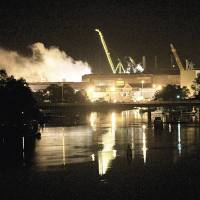 Photo -   FILE - In a Wednesday, May 23, 2012 file photo, smoke rises from a dry dock as fire crews respond to a fire on the USS Miami SSN 755 submarine at the Portsmouth Naval Shipyard on an island in Kittery, Maine. U.S. Attorney Thomas Delahanty II said 24-year-old Casey James Fury waived indictment and pleaded guilty Thursday, Nov. 8, 2012 to two counts of arson for setting the fire that caused about $450 million in damage, in Portland, Me. (AP Photo/The Herald, Ionna Raptis, File)
