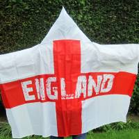 Photo - A man models a wearable England flag, made by Asda, in London, Friday, May 30, 2014. British supermarket chain Asda has been criticized for launching a wearable England flag ahead of the World Cup that some customers say resembles an outfit worn by U.S. far-right organization the Ku Klux Klan. Designers of the flag _ a St. George's Cross with the word 'England' on it _ included a white hood so fans could stay dry while wearing it. (AP Photo/PA, Carmel Wilkinson) UNITED KINGDOM OUT