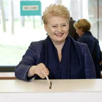 Photo - Lithuania's President Dalia Grybauskaite, a presidential candidate, casts her ballot at a polling station during the first round presidential elections in Vilnius, Lithuania, Sunday, May 11, 2014. Grybauskaite is widely expected to win a second term in Lithuania's presidential election. (AP Photo/Mindaugas Kulbis)