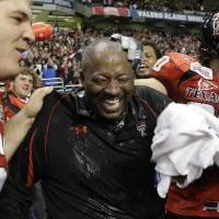 Photo - Texas Tech interim coach  Ruffin  McNeill, center, celebrates with his players following their win in the Alamo Bowl NCAA college football game against Michigan State in San Antonio, Saturday, Jan. 2, 2010. Texas Tech won 41-31. (AP Photo/Eric Gay)