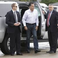 Photo -   Republican presidential candidate and former Massachusetts Gov. Mitt Romney gets out of his vehicle before boarding his campaign plane in West Palm Beach, Fla., Friday, Sept. 21, 2012. (AP Photo/Charles Dharapak)