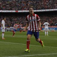 Photo - Atletico's Koke celebrates his goal during a Spanish La Liga soccer match between Atletico de Madrid and Real Madrid at the Vicente Calderon stadium in Madrid, Spain, Sunday, March 2, 2014. (AP Photo/Gabriel Pecot)