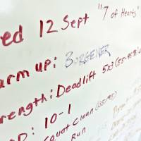 Photo - Part of the warm up is listed on the white board at Crossfit Native  CHRIS LANDSBERGER - CHRIS LANDSBERGER