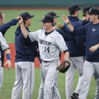 Photo - Xavier pitcher Sean Campbell, center, celebrates with his teammates after their 5-3 win over Seton Hall in an NCAA college baseball game in the Big East Conference tournament, Saturday, May 24, 2014, in New York. (AP Photo/John Minchillo)