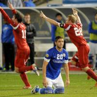 Photo - Creighton's Christian Blandon reacts to the 1-0 loss to Indiana as Indiana's Patrick Doody, left, and Caleb Konstanski celebrate after an NCAA men's College Cup semifinal soccer game in Hoover, Ala., Friday, Dec. 7, 2012. (AP Photo/ AL.com, Mark Almond)