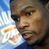Photo - Oklahoma City's Kevin Durant speaks to the media during a press conference at the Oklahoma City Thunder NBA basketball team practice facility in Oklahoma City, Monday, May 16, 2011. Photo by John Clanton, The Oklahoman ORG XMIT: KOD