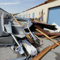 Photo - Willie Nean Yarbrough?s collection of angels was stored in this storage facility after a tornado hit her home May 20. Weeks later, a storm took the roof off the unit where her belongings were stored after the tornado. Photo by Steve Sisney, The Oklahoman  STEVE SISNEY