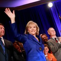 Photo -  Governor elect of Oklahoma Mary Fallin and her husband Wade Christensen greet supporters as they are take the stage during the Republican Watch Party at the Marriott in Oklahoma City on Tuesday, Nov. 2, 2010.Photo by John Clanton, The Oklahoman ORG XMIT: KOD