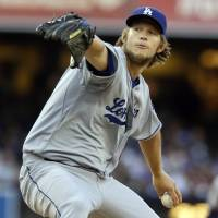 Photo - Los Angeles Dodgers starting pitcher Clayton Kershaw delivers against the San Diego Padres in the first inning of a baseball game Saturday, Sept. 21, 2013, in San Diego. (AP Photo/Lenny Ignelzi)