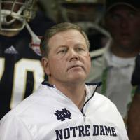 Photo - FILE - Notre Dame head coach Brian Kelly watches play against Alabama during the second half of the BCS National Championship college football game in this Jan. 7, 2013 file photo taken in Miami. The Philadelphia Eagles interviewed Notre Dame coach Brian Kelly Tuesday Jan 8, 2013 for their coaching vacancy, a person familiar with the meeting told The Associated Press.  (AP Photo/Chris O'Meara)