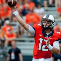 Photo - Illinois quarterback Wes Lunt (12) throws the ball during the second quarter of an NCAA college football game against Youngstown State, Saturday, Aug. 30, 2014, at Memorial Stadium in Champaign, Ill. (AP Photo/Bradley Leeb)