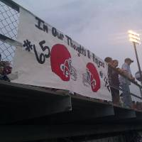 Photo - A sign in memory of Cory Casinger and Gordon Parsons hangs on the bleachers at the Stiger-Eufaula game on Friday, Sept. 28. PHOTO BY RYAN ABER, THE OKLAHOMAN