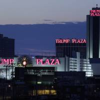 Photo - FILE - This Feb. 29, 2012 file photo shows the Trump Plaza Hotel and Casino and Caesars Atlantic City Hotel and Casino, left back, in Atlantic City, N.J. The rapid disintegration of Atlantic City's casino market might be an early indicator of what could happen in other parts of the country that have too many casinos and not enough gamblers. (AP Photo/Mel Evans, File)