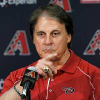 Photo - Tony La Russa, newly hired as chief baseball officer for the Arizona Diamondbacks, speaks to reporters after being introduced Saturday, May 17, 2014, in Phoenix. (AP Photo/Matt York)