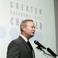 Photo - Mayor Mick Cornett discusses a new series of jobs being offered by AT&T on Thursday during a news conference at the Oklahoma City Chamber of Commerce. Photo by Paul Hellstern, The Oklahoman