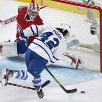 Photo - Montreal Canadiens' goaltender Carey Price can't stop a goal by Toronto Maple Leafs' Tyler Bozak (42) during the first period of an NHL hockey game in Montreal, Saturday, Feb. 9, 2013. (AP Photo/The Canadian Press, Graham Hughes)