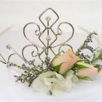 Photo - This product image released by Gillespie Florists, Inc. shows a tiara made of rhinestones, two peach sweetheart roses, a few small florets of white hydrangea bloom and limonium.  (AP Photo/Gillespie Florists, Inc.)