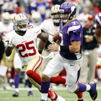 Photo -   Minnesota Vikings quarterback Christian Ponder (7) runs from San Francisco 49ers cornerback Tarell Brown (25) during a touchdown run in the first half of an NFL football game, Sunday, Sept. 23, 2012, in Minneapolis. (AP Photo/Genevieve Ross)