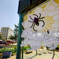 Photo - Knitted art is displayed in the Enid town square as part of the Yarnover Enid community art event on Friday.  Photo by Chris Landsberger, The Oklahoman  CHRIS LANDSBERGER - CHRIS LANDSBERGER