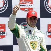 Photo - Ed Carpenter celebrates after winning the pole during qualifications for the Indianapolis 500 IndyCar auto race at the Indianapolis Motor Speedway in Indianapolis, Sunday, May 18, 2014. (AP Photo/Michael Conroy)