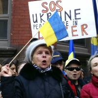 Photo - CORRECTS TO UKRAINIAN CONSULATE INSTEAD OF EMBASSY - Maria Semkiv, 66, gathers with others outside the Ukrainian Consulate in Chicago, Wednesday, Feb. 19, 2014, to protest the deadly violence in the Ukraine capital of Kiev and call for a stronger response by the United States and the European Union. Clashes on Tuesday left 25 people dead in the worst violence in nearly three months of anti-government protests in Ukraine's capital. Protests began after the president backed away from a deal to join the European Union. (AP Photo/Tammy Webber)