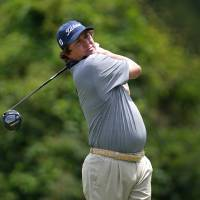 Photo -   Jason Dufner tees off on the second hole during the third round of the Zurich Classic golf tournament at TPC Louisiana in Avondale, La., Saturday, April 28, 2012. (AP Photo/Gerald Herbert)