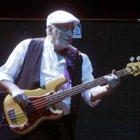 Photo - FILE - This April 8, 2013 file photo shows bassist John McVie performing during a Fleetwood Mac concert at Madison Square Garden in New York. The New Orleans Jazz and Heritage festival begins Friday, April 25. This year's headliners are big, including Billy Joel, Fleetwood Mac, Hall and Oates, The Black Keys, Maroon 5, Jill Scott, Kem, Frank Ocean and the Dave Matthews Band.  (Photo by Jason DeCrow/Invision/AP, file)