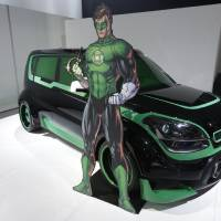 Photo - The Green Lantern-wrapped Kia Soul is on display at the North American International Auto Show in Detroit, Tuesday, Jan. 15, 2013. The Batman-decorated Kia Optima and the Green Lantern-wrapped Kia Soul are at the South Korean automaker's exhibit to promote an effort to fight hunger in Africa. Features include the Green Lantern's symbol on the Soul's wheels. The vehicles were created as part of a partnership involving DC Entertainment. The