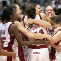 Photo - WOMEN'S COLLEGE BASKETBALL, OU, NCAA TOURNAMENT: University of Oklahoma vs Duke University in the Final Four 2002 NCAA Women's Basketball Tournament played at the Alamodome in San Antonio, Texas,  Friday March 29, 2002.  Celebration after the game. Staff photo by Doug Hoke.