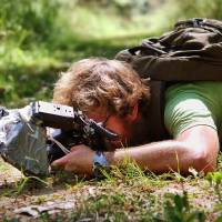 Photo - Thomas Shahan photographs an insect for inclusion in the exhibit