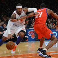 Photo -   New York Knicks' Carmelo Anthony, left, drives on the Philadelphia 76ers' Thaddeus Young in the first quarter of the NBA basketball game at Madison Square Garden in New York, Sunday, Nov. 4, 2012. (AP Photo/Henny Ray Abrams)