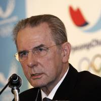 Photo - International Olympic Committee (IOC) President Jacques Rogge speaks during a press conference in Seoul, South Korea, Friday, Feb. 1, 2013. Rogge arrived in South Korea on Wednesday for a four-day visit to inspect ongoing preparations for the 2018 Pyeong Chang Olympic Winter Games in the South Korean alpine city. (AP Photo/Ahn Young-joon)