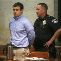 Photo - Tristan Owen, 17, is led from the courtroom after being found guilty of two counts of manslaughter and one count of arson in an Oklahoma City, Friday, Feb. 22, 2013. Photo by Bryan Terry, The Oklahoman