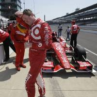 Photo - Scott Dixon, of New Zealand, wipes his face following a practice session for the inaugural Grand Prix of Indianapolis IndyCar auto race at the Indianapolis Motor Speedway in Indianapolis, Thursday, May 8, 2014. (AP Photo/Darron Cummings)