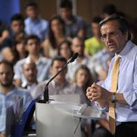 Photo -   Antonis Samaras, leader of the conservative New Democracy party, speaks during an election rally in the northern Greek city of Thessaloniki, on Thursday, June 14, 2012. Greece holds crucial new national elections on Sunday June 17, that could ultimately determine whether the deeply-indebted, recession bound country remains within the eurozone. First elections on May 6 resulted in a hung parliament.(AP Photo/Nikolas Giakoumidis)