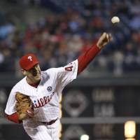 Photo - Philadelphia Phillies' Cliff Lee pitches during the third inning of a baseball game against the Atlanta Braves, Wednesday, April 16, 2014, in Philadelphia. (AP Photo/Matt Slocum)