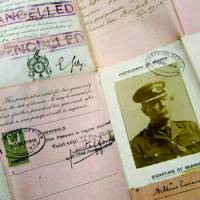 Photo - This May 13, 2004 file photo shows Sir Arthur Conan Doyle's passport dating from World War I on display at Christie's auction house in London. The passport and some 3,000 other items were among Doyle's lost papers that were found in a London law firm's archive where they were stored and forgotten after they were taken from Doyle's writing desk in 1930, following his death. Arthur Conan Doyle met with troops in the spring of 1916 and completed his work