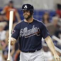 Photo - Atlanta Braves' Evan Gattis tosses his bat after he struck out swinging during the fourth inning of a baseball game against the Miami Marlins, Tuesday, April 29, 2014, in Miami. (AP Photo)