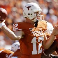 Photo - COLLEGE FOOTBALL: Quarterback Colt McCoy passes as Oklahoma State University (OSU) plays the University of Texas (UT) at Darrell K. Royal-Texas Memorial Stadium at Joe Jamail Field in Austin, Texas on Saturday October 25, 2008. By Doug Hoke, The Oklahoman  ORG XMIT: KOD