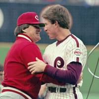 Photo - FILE - In this May 2, 1987, file photo, Philadelphia Phillies' Mike Schmidt, right, is congratulated by Cincinnati Reds manager and former teammate Pete Rose during a pregame ceremony honoring Schmidt for hitting his 500th home run, in Philadelphia. On the 25th anniversary of Rose's banishment from baseball, Schmidt says it is time to forgive him and put him in the Hall of Fame. (AP Photo/David Fields, File)