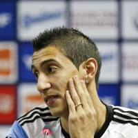Photo - Argentina's Angel di Maria gestures during a news conference in Vespesiano, near Belo Horizonte, Brazil, Sunday, June 22, 2014.  Argentina plays in group F of the 2014 soccer World Cup. (AP Photo/Victor R. Caivano)