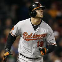 Photo - Baltimore Orioles' Chris Davis watches his solo home run against the Boston Red Sox during the second inning of a baseball game at Fenway Park in Boston, Thursday, April 11, 2013. (AP Photo/Winslow Townson)