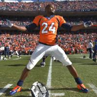 Photo - In this Jan. 19, 2014, photo, Denver Broncos cornerback Champ Bailey warms up before the AFC championship NFL playoff football game against the New England Patriots in Denver. In a cost-cutting move Thursday, March 6, 2014, the Broncos released Bailey, the team's defensive leader who's been a fan favorite since he was acquired in a trade with Washington in 2004. (AP Photo/Jack Dempsey)