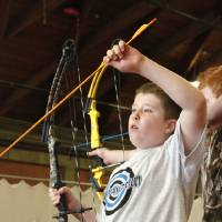Photo - Fifth-grader Will Jordan, age 10, from Sequoyah Elementary in Shawnee, selecting an arrow while participating in a regional